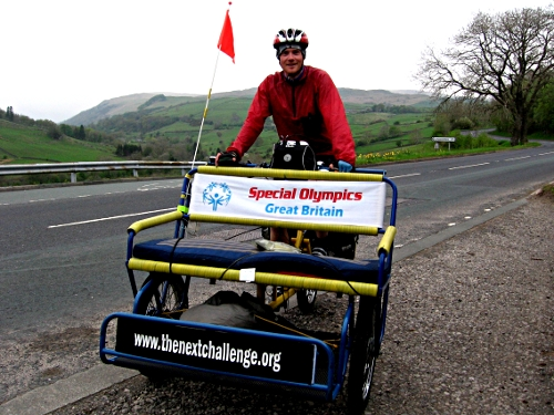 Tim and rickshaw coming off the 1,400ft A6 summit by Shap