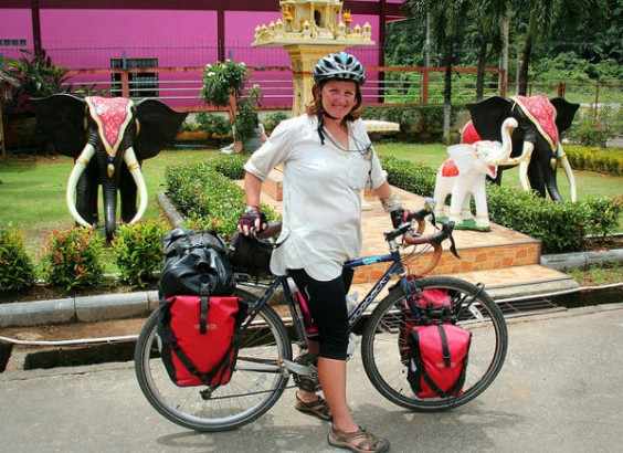 Cycling past a Thailand Shrine
